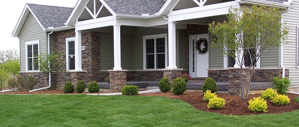 Photo of a home with landscaping detail provided by DIY Pro program.