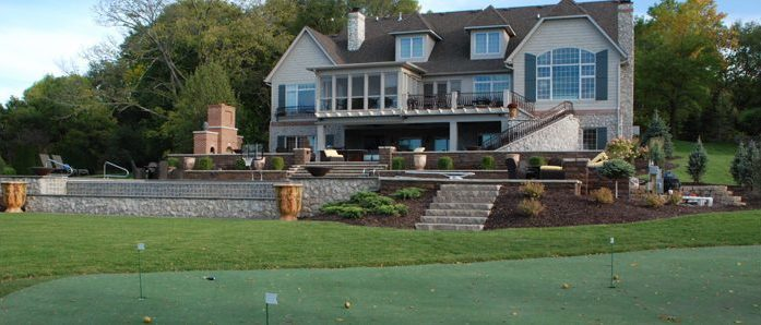 outdoor living with golf holes in backyard