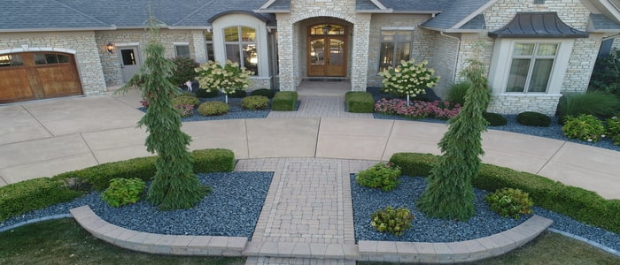 landscaping in the front of a large circle drive