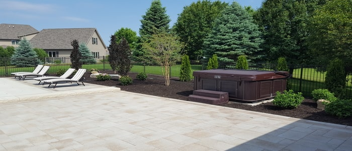 landscaping around hot tub and patio