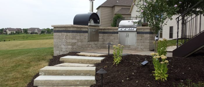 outdoor living grill area with stone steps